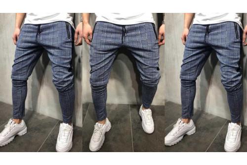 Чоловічі спортивні штани: переваги і якості одягу для спорту